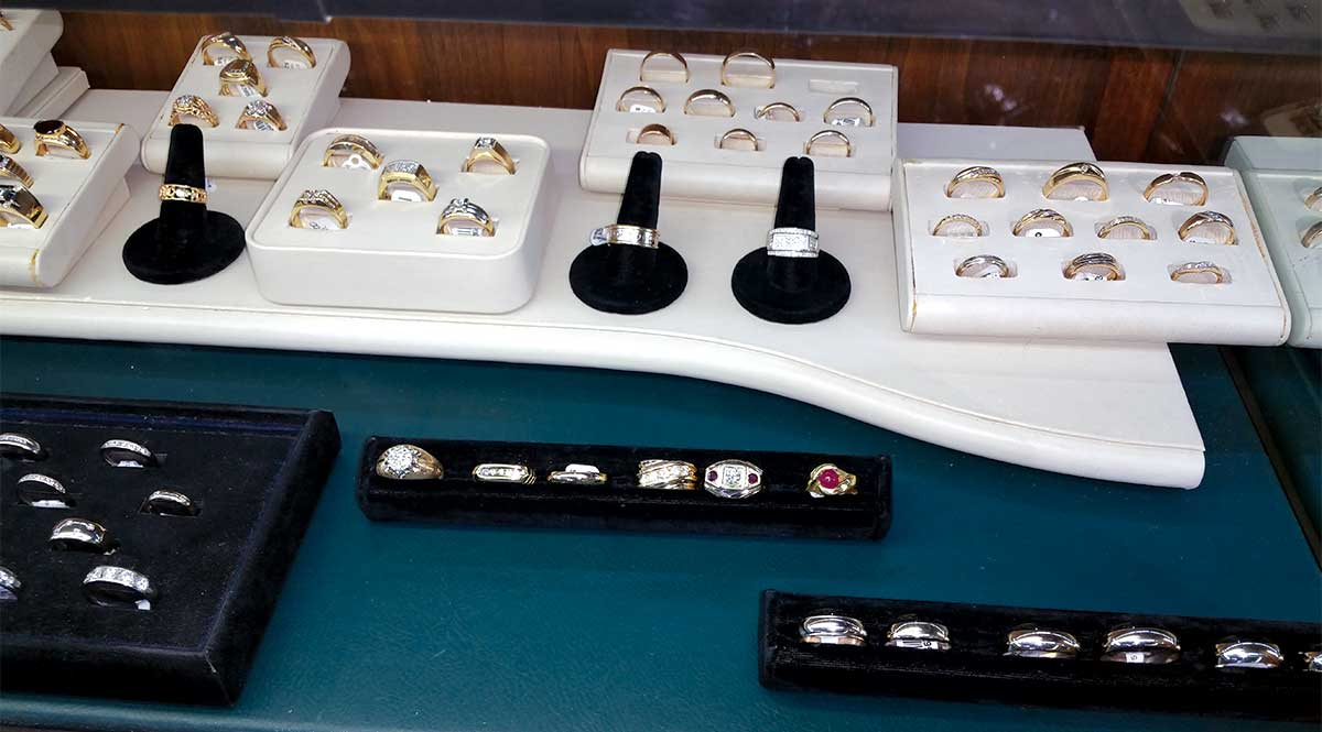 various types of rings for sale in a display case
