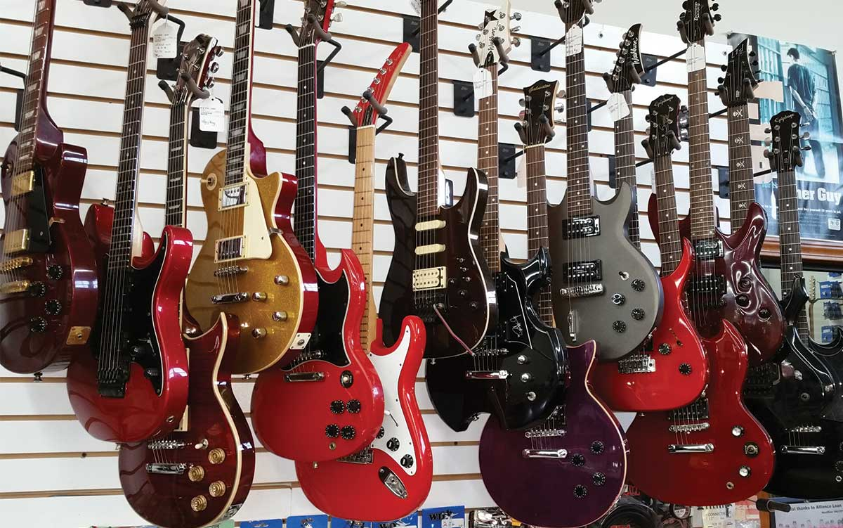 electric guitars for sale on display