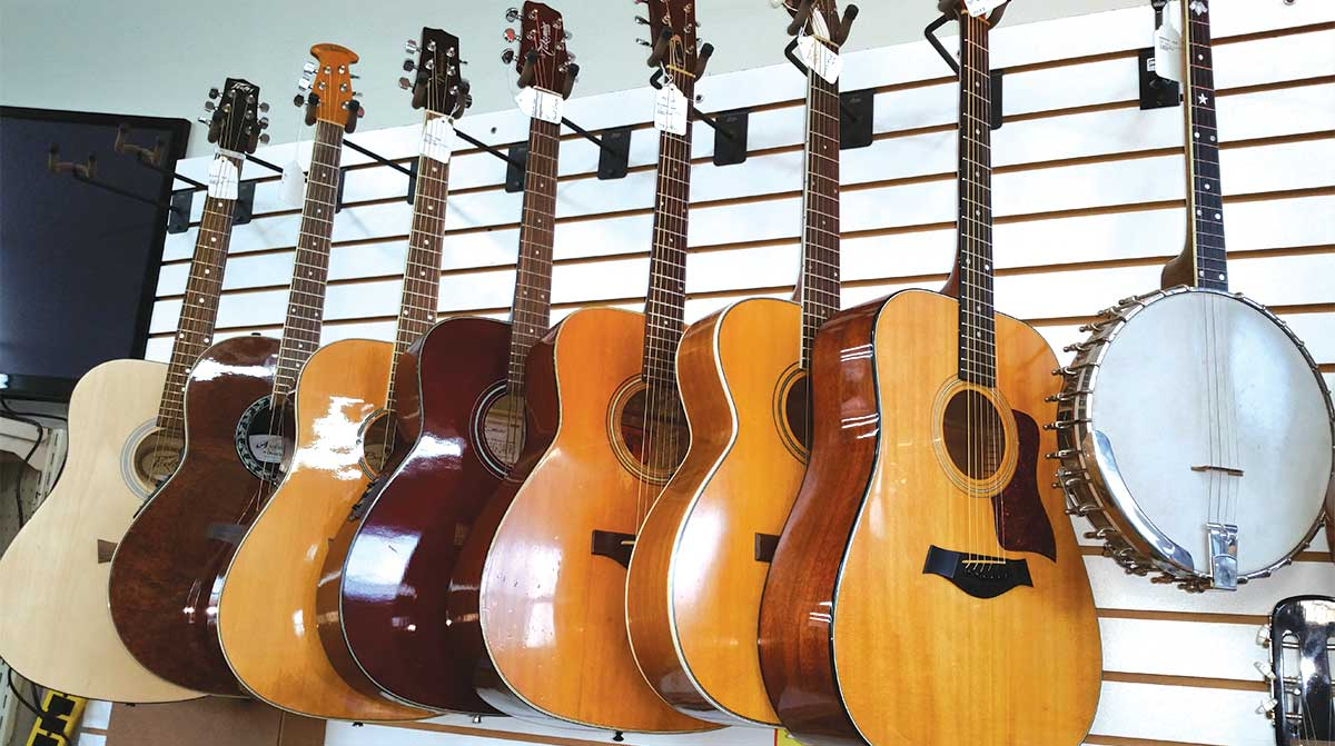 acoustic guitars for sale on display