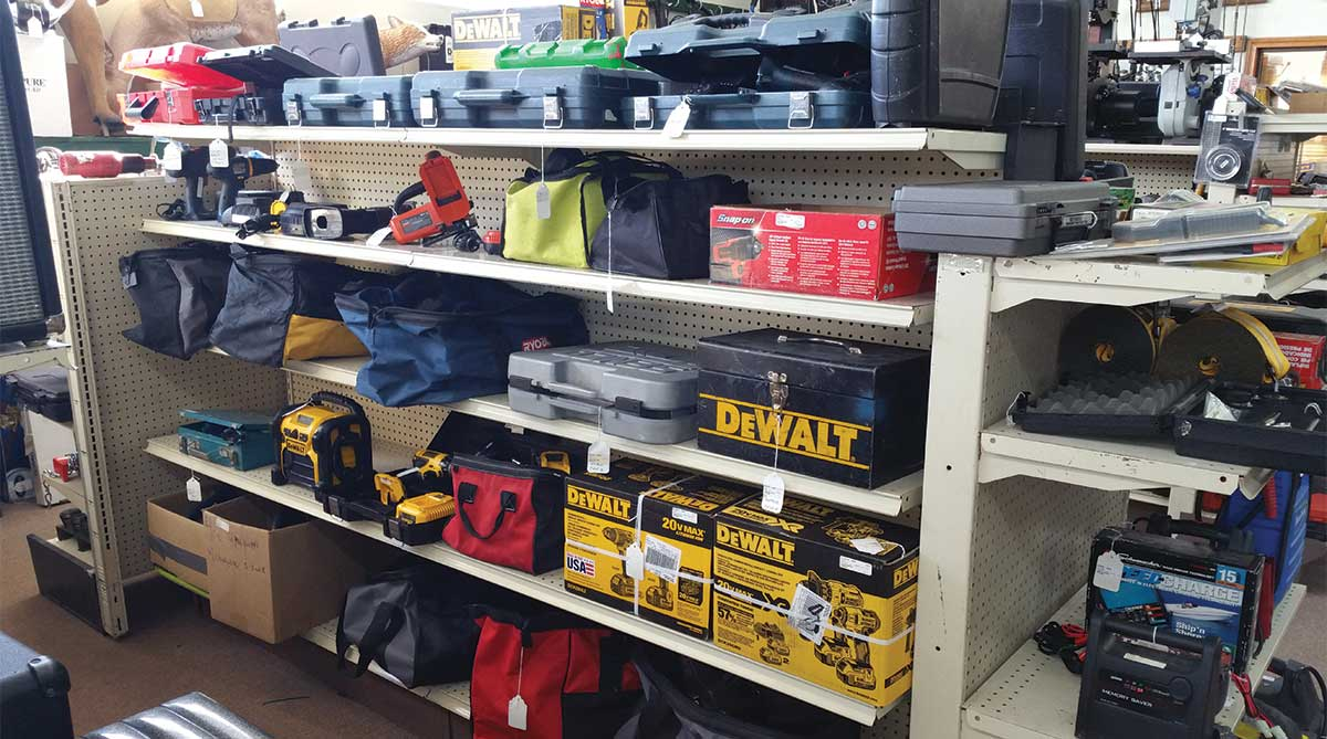 tools with bags and cases for sale on a shelf