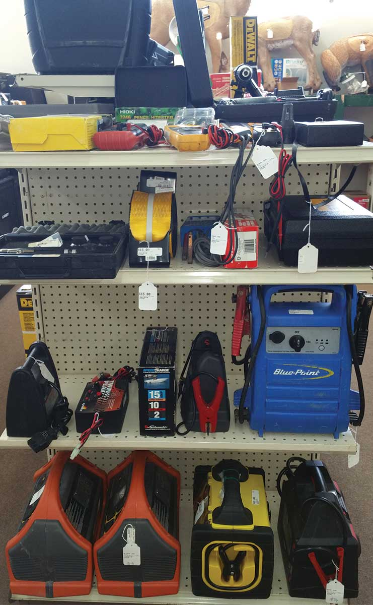 tools on a shelf with price tags