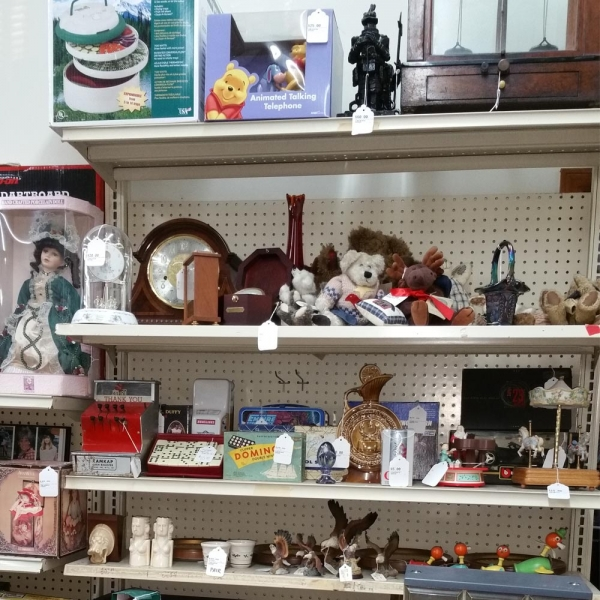 shelf with different collectibles for sale