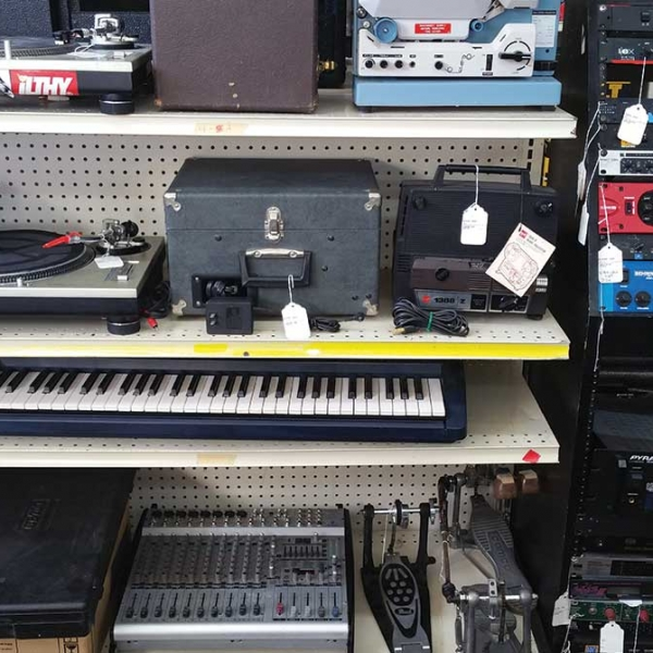 musical instruments on a shelf for display